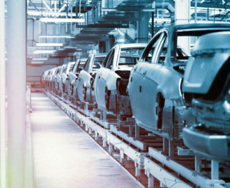 vehicle manufacturing showing cars on assembly line AMI Strategies offers AI-powered software